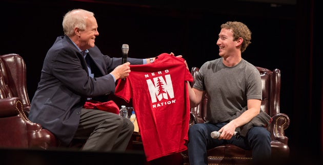 John Hennessy presenting a T-shirt to Mark Zuckerberg