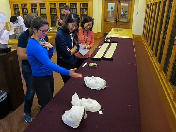 Students examining artifacts