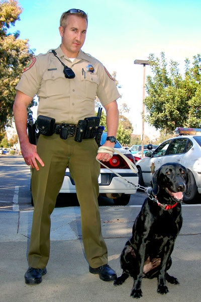 Deputy Adam Cullen with K-9 Red