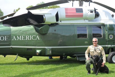 Deputy Adam Cullen with K-9 Red in front of presidential helicopter / SUDPS