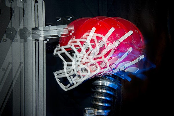 A multiple exposure shows the effect of an impact to the top of the helmet in a laboratory experiment.
