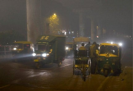 Smog under a metro overpass in Delhi, India