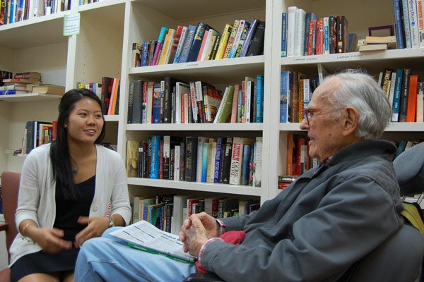 Student Giselle Tran interviewing retired physicist William Frye