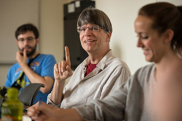 Professor Richard Powers, center, in class discussion, sits between Diego Aguilar-Canabal, left, and Alex Simon, right.