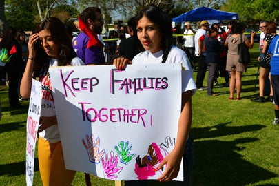 women at a rally for immigration reform / Richard Thornton/Shutterstock