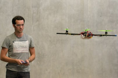 student controlling quadcopter with phone / Nora Sweeny