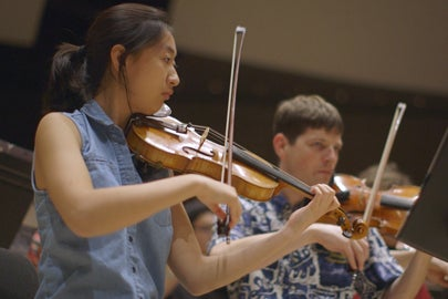 members of Stanford Symphony Orchestra rehearsing / Kurt Hickman