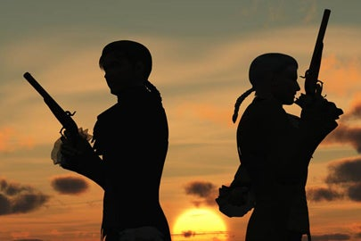 duelers in silhouette / Mike H/Shutterstock