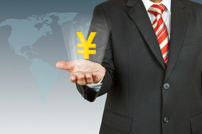 Businessman holding symbol of Japanese yen