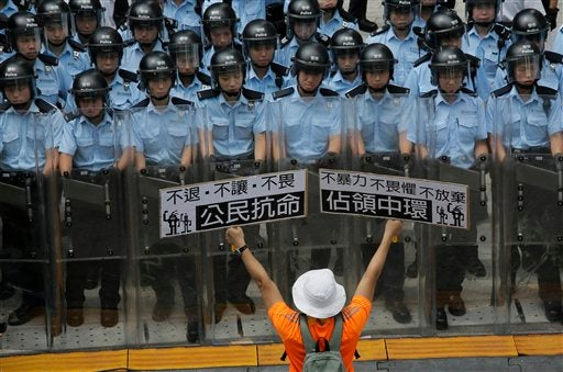 Protester in front of riot police in Hong Kong during Sept. 2014 protests