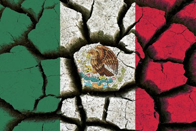 Mexican flag and parched earth / iStock/mustafabilgesatkin
