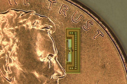 Tiny radio-on-a-chip resting on a penny/Photo: Courtesy of Amin Arbabian