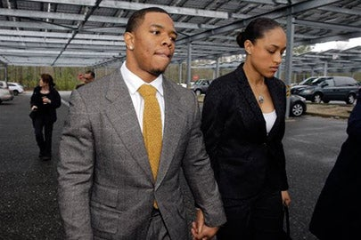 NFL star Ray Rice holds hands with his wife, Janay Palmer, as they arrive at Atlantic County Criminal Courthouse in Mays Landing, N.J./Photo: Mel Evans, AP