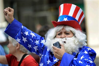 woman at a rally dressed as Uncle Sam / Paul Beaty/AP Photo