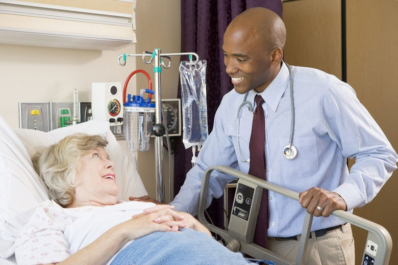 doctor with patient in hospital / Monkey Business Images/Shutterstock