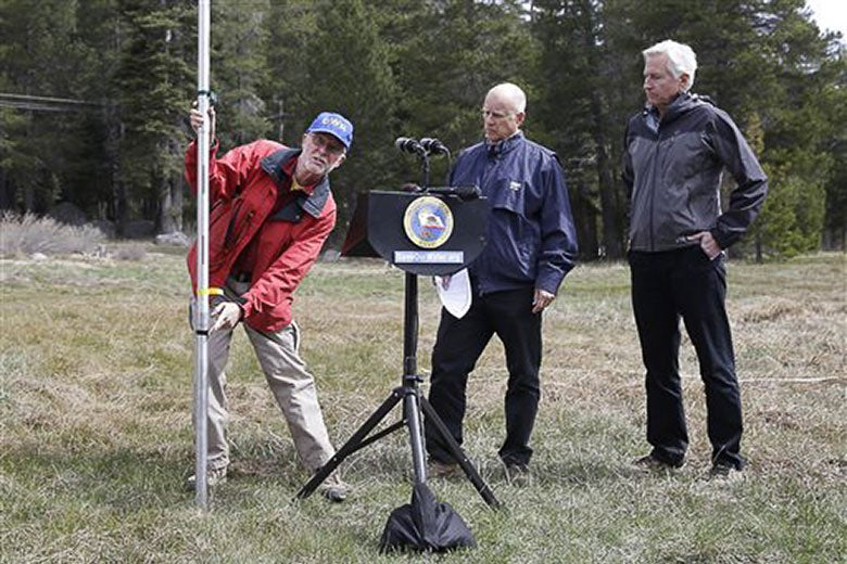 California officials observing lack of snow on Echo Summit on April 1, 2015 / AP Photo/Rich Pedroncelli