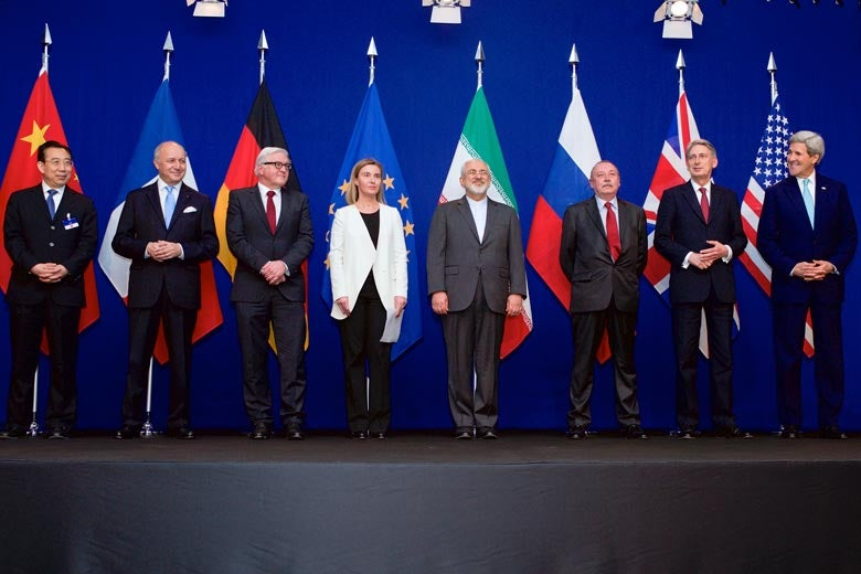 Officials from countries participating in Iran nuclear talks standing in front of their flags/ Photo: Glen Johnson
