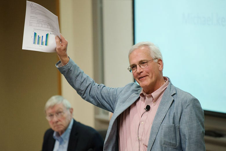 Michael Keller holding up papers / Photo: L.A. Cicero