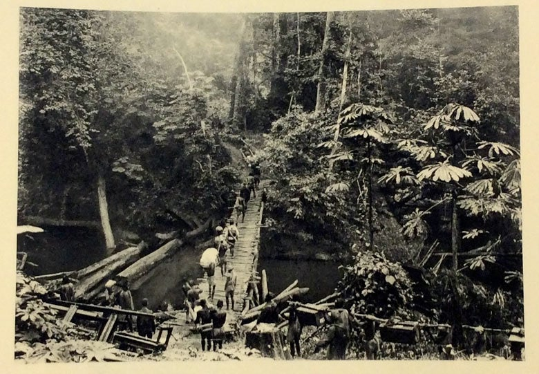 porters carrying supplies for construction of Congo-Ocean Railway