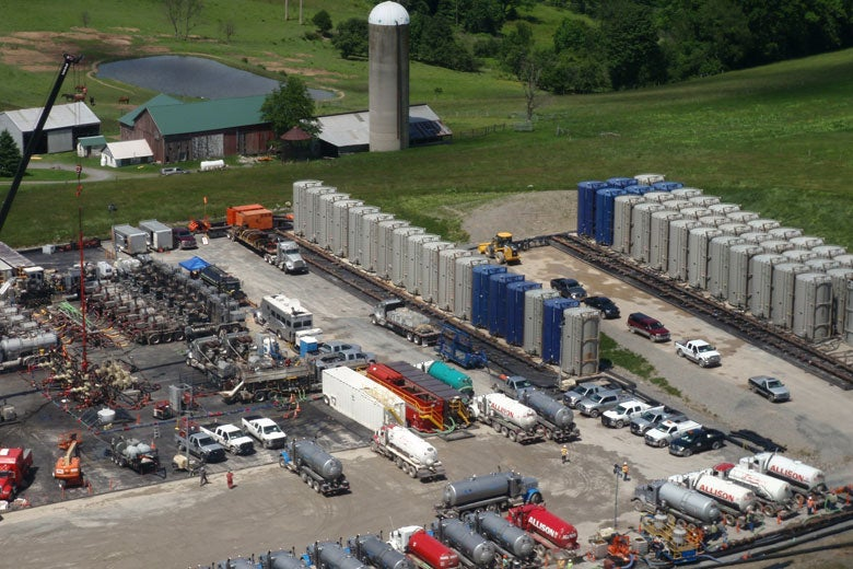 fracking operations at a well pad near a farm / Robert Jackson