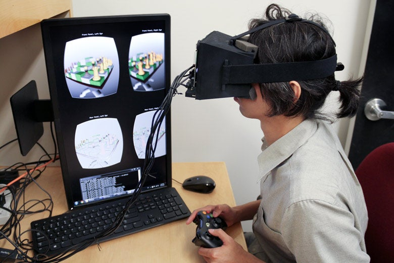 Fu-Chung Huang demonstrates the new light-field stereoscope virtual reality headset in the Stanford Computational Imaging Group lab / Vignesh Ramachadran