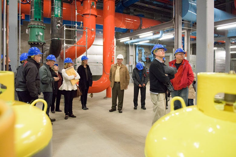Members of the Faculty Senate in hard hats walking through the facility