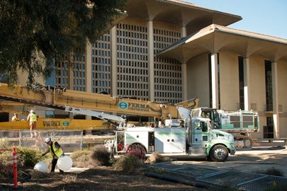 crew, equipment preparing for demolition outside Meyer Library / L.A. Cicero