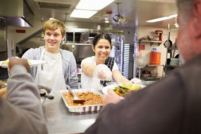 Volunteers at a soup kitchen / Monkey Business Images/Shutterstock