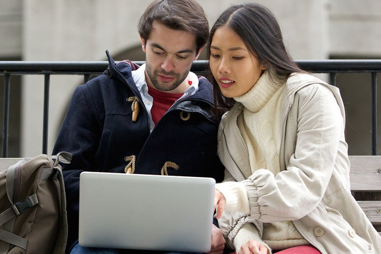 couple looking at a laptop computer screen