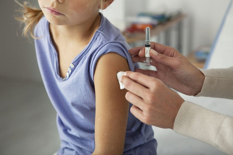 girl receiving vaccination / Image Point Fr/Shutterstock