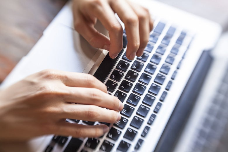 hands typing on computer keyboard / De Visu/Shutterstock