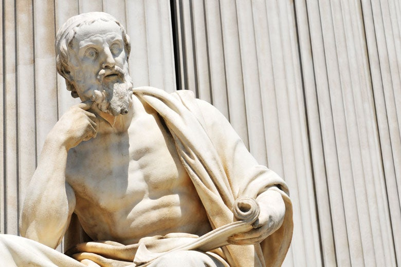 Statue of ancient philosopher holding a scroll.