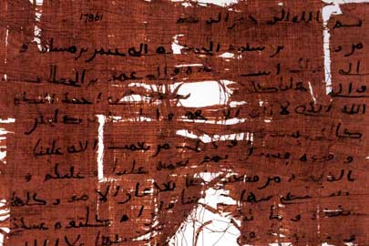 Tattered fragment of papyrus with writing. / Courtesy Oriental Institute, University of Chicago
