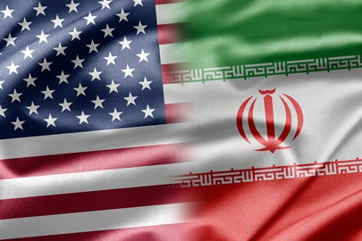 U.S. and Iranian flags / ruskpp/Shutterstock