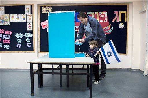 Israeli man with his daughter voting in Tel Aviv on March 17, 2015