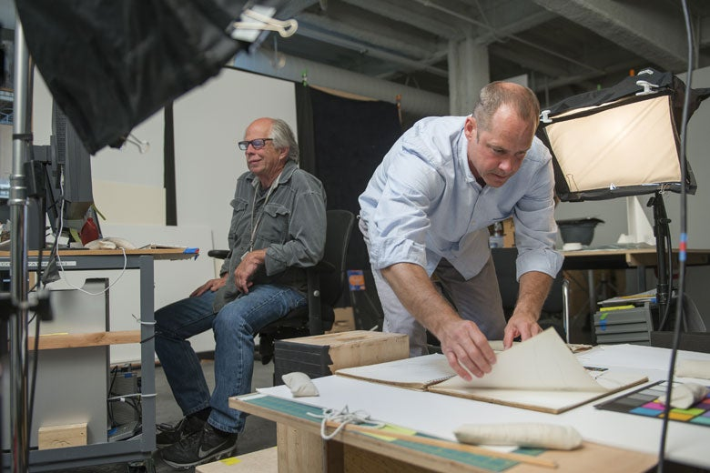 Photographer Lee Fatheree, left, and Digitization Project Coordinator Colin Stinson work on photographing the sketchbooks of Richard Diebenkorn at Stanford's Cantor Arts Center / L.A. Cicero