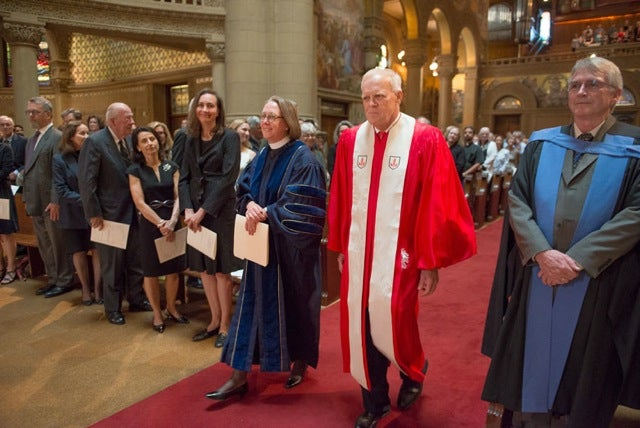 Jane Shaw and John Hennessy walking up the aisle of Memorial Church