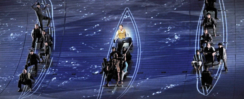 Scene from Jake Heggie's opera Moby-Dick; digital effects recreate whaling boats