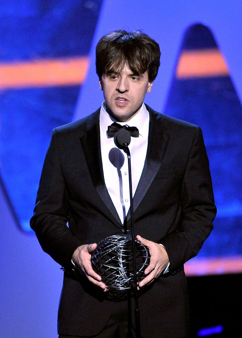 Karl Deisseroth at microphone with prize