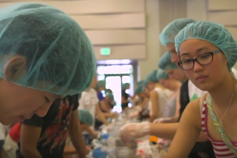 students on an assembly line packaging meals / Kurt Hickman