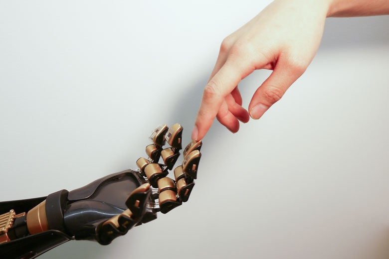 Human hand touching mechanical hand