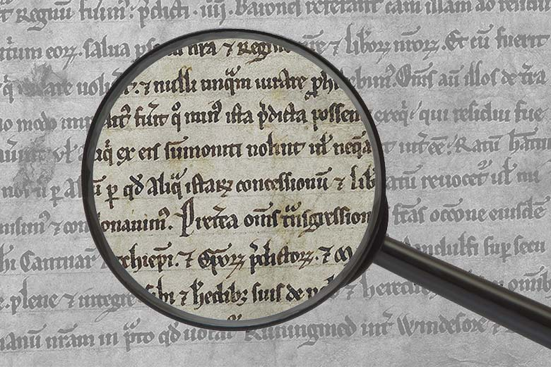 Magnifying glass over text of the Magna Carta/Photo illustration by L.A. Cicero