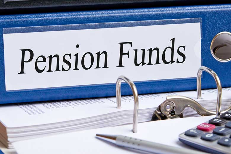 binder labeled 'pension funds' with calculator on desk / docstockmedia/Shutterstock