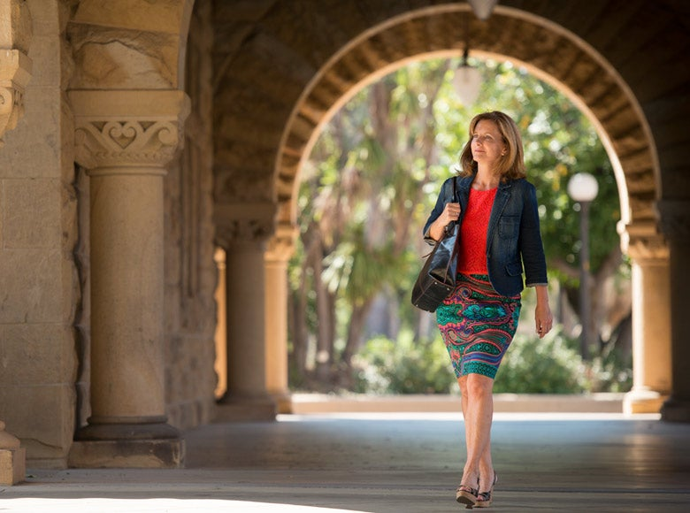 DCI Fellow Kate Jerome walking in Quad arcade