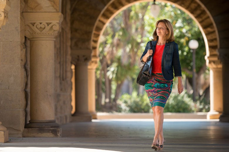 DCI Fellow Kate Jerome walking in Quad arcade / L.A. Cicero