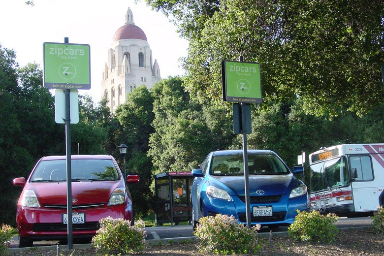 Photo of Zip Cars on the Oval with Hoover Tower in the background./ Photo courtesy of Parking & Transportation Services