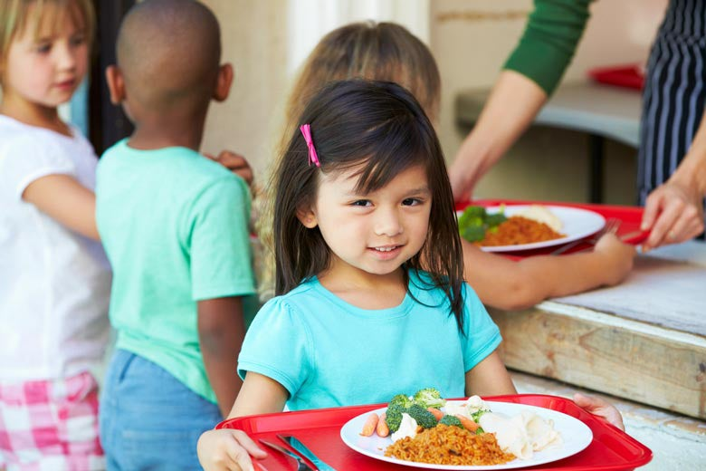 Child with school lunch