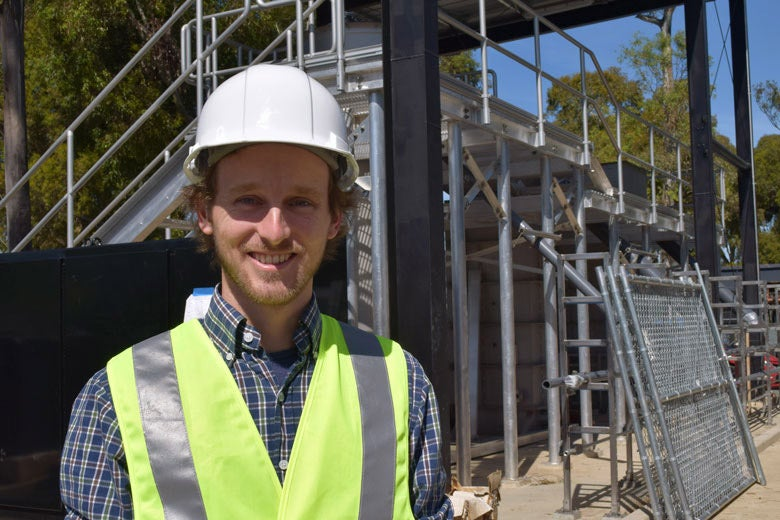 Sebastien Tilmans in front of the William and Cloy Codiga Resource Recovery Center