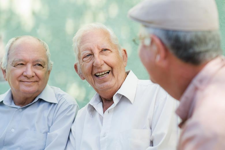 Three old men chatting happily
