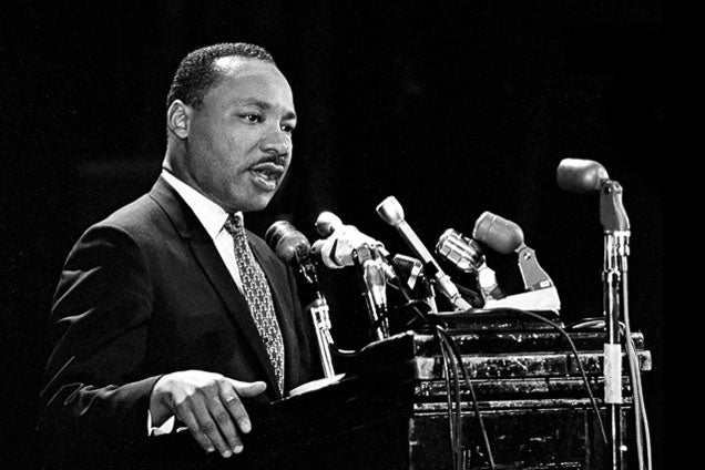 Martin Luther King Jr. at the podium of Memorial Auditorium on April 14, 1967 / Chuck Painter/Stanford News Service
